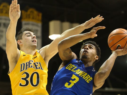 Delaware's Anthony Mosley (right) gets a shot over