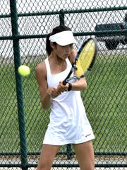Mason's Jamie Kim powers back a service return at the GCTCA Coaches Classic. Sept. 14, 2017 - Geoff Blankenship for The Enquirer