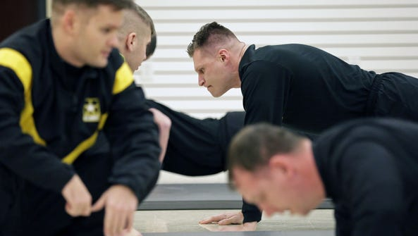 Sgt. Petr Eliseev, center, a future drill sergeant,