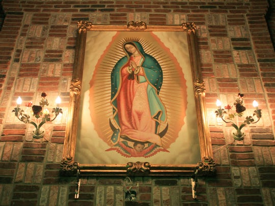 The Lady of Guadalupe high above the dining room at Javier's Hacienda.