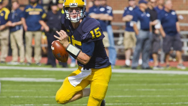 Michigan quarterback Jake Rudock (15) scrambles with the football in the fourth quarter of an NCAA college football game against BYU in Ann Arbor, Mich., Saturday, Sept. 26, 2015. Michigan won 31-0. (AP Photo/Tony Ding)