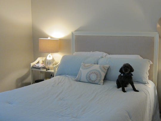 The master bedroom features calming colors that add to the feel of being a peaceful refuge for the Halls and their pets.