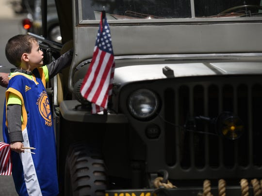 Midland Park's Memorial Day parade on Saturday May 27, 2017. Logan Marchetti, 6 years old, looks inside and army jeep.