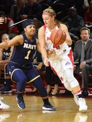 Marist College's Allie Clement dribbles past Navy's Taylor Dunham at McCann Arena on Nov. 10, 2017.