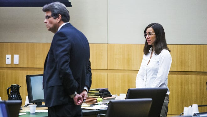 Defense attorney Kirk Nurmi (left) has been sued by his former client, convicted murderer Jodi Arias (right), over a book he wrote about her trial.