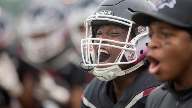 A member of the Peoria High football team yells with enthusiasm before the opening night of the 2018 high school football season at Peoria Stadium.