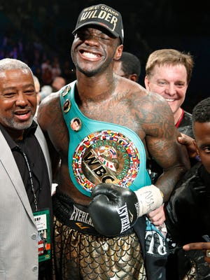 Deontay Wilder celebrates after defeating Bermane Stiverne in their WBC heavyweight titleboxing bout Saturday, Jan. 17, 2015, in Las Vegas. (AP Photo/John Locher)