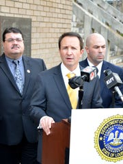 Louisiana State Attorney General Jeff Landry announces six arrests in bribery scandal at a press conference in Lafayette on Feb. 1. Shown are   Donald Bostic, FBI (from left); Joe Picone, investigation director; Brandon Fremin, criminal director; and Assistant Attorney General, Sonceree Smith Clark.