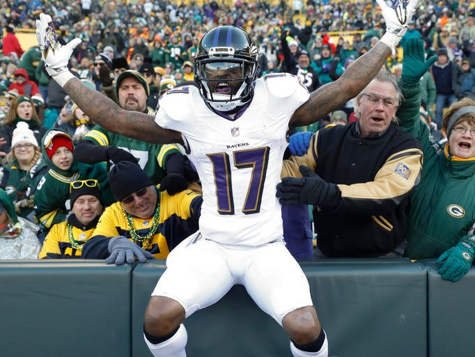 Baltimore Ravens' Mike Wallace celebrates in the stands