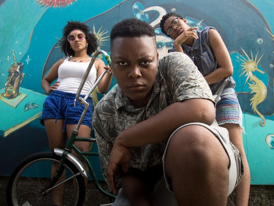 """Milwaukee rapper Chakara Blu (center) recorded a """"recovery song"""" called """"Rock"""" inspired by her first-hand experiences in Sherman Park Aug. 13. Fivy (left) contributed to the track. Also pictured: local singer Dria."""