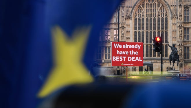 "A protest placard reading ""We Already Have The Best Deal"" is seen near the Houses of Parliament as the week begins on Jan. 21, 2019, in London, England."