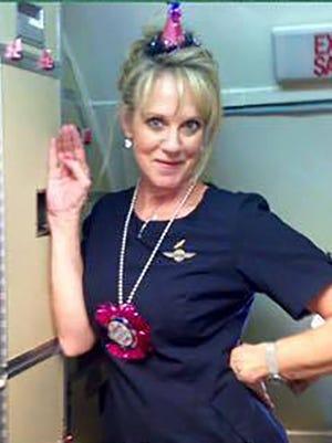 LouAnn Alexander at work wearing her flight attendant wings in 2015.