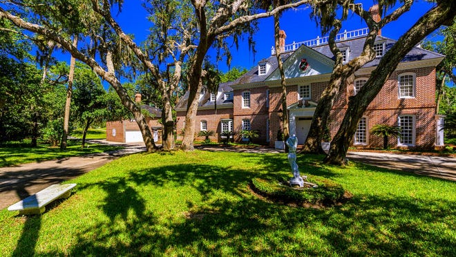 One of the Daytona Beach's most admired waterfront estates features a 7,000-square-foot main home, guest house and outbuildings that are situated beneath ancient oaks atop a bluff on a private 2.7 acres of rolling terrain, with an unheard of 248 feet of Intracoastal frontage.