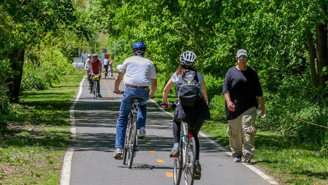 The East Bay Bike Path heading into Barrington is full of residents taking advantage of Saturday's beautiful weather.