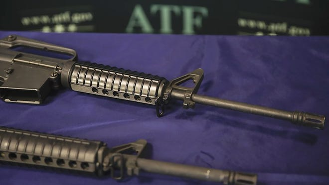 Examples of homemade rifles are shown at an ATF field office in Glendale, Calif.