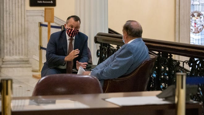 House Ways and Means Chairman Aaron Michlewitz and House Majority Leader Ron Mariano had a sidebar outside the chamber Tuesday afternoon during a busy week of legislating. The House voted the next day to continue formal sessions past July 31, and the Senate agreed Thursday.