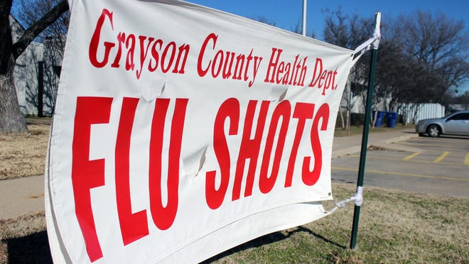 This 2014 file photo of a flu shot sign outside the Grayson County Health Department would seem right at home there again this month as the department is urging locals to get their flu shot now.