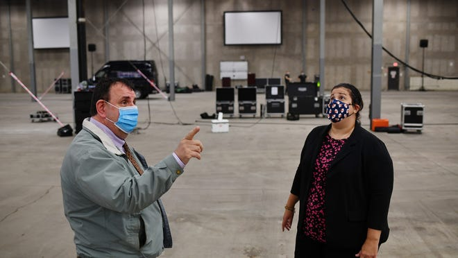 Town Manager David Genereux and Assistant Town Manager Kristen Forsberg view the old Millbrook Distributors warehouse being prepared for the special town meeting on Saturday.