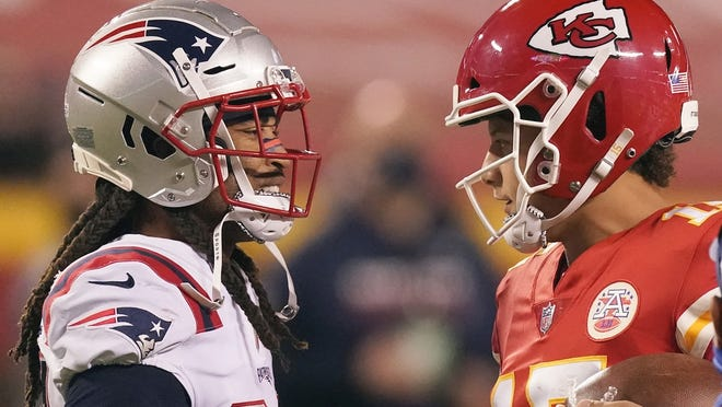 New England Patriots cornerback Stephon Gilmore, left, talks with Kansas City Chiefs quarterback Patrick Mahomes after an NFL football game, Monday, Oct. 5, 2020, in Kansas City. The Chiefs won 26-10.