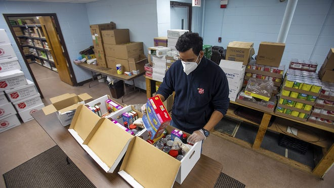 Lt. Stephen Rivero, 29, of the Salvation Army on Centre Street in Brockton pre-packs boxes of food on Wednesday, Sept. 23, 2020.