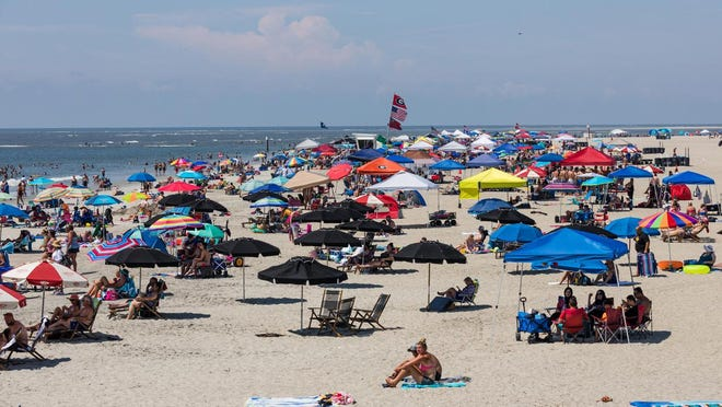 Tents and umbrellas dot the sand as visitors enjoy the Tybee Island beaches on Saturday, July 4th.