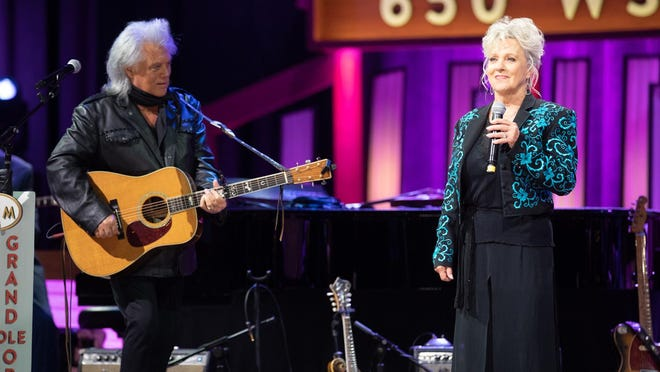 Marty Stuart and Connie Smith perform on the Grand Ole Opry stage on Sept. 26 for the Opry's 4,943rd Saturday night broadcast. The show has gone on despite the venue being closed to a live audience during the COVID-19 pandemic.