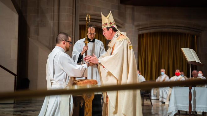 Mark Tibai, who grew up in Carleton, was ordained a priest by Archbishop Allen H. Vigneron June 1.