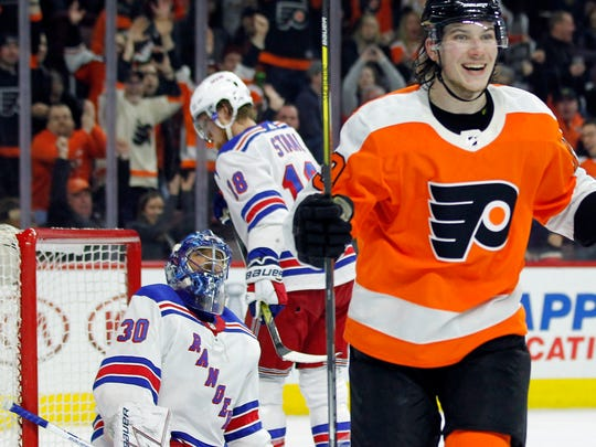 Philadelphia Flyers' Nolan Patrick, right, smiles as he skate over to congratulate Claude Giroux, not pictured, on his goal during the second period of an NHL hockey game against the New York Rangers, Saturday, April 7, 2018 in Philadelphia, PA.
