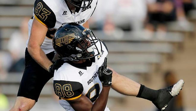 Southern Miss' Casey Martin (83) celebrates with teammate Mike Thomas (88) after a touchdown against Rice on Saturday