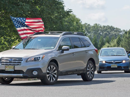 A small but dedicated group of protesters with Indivisible NJ 4th District drove their cars around the front of Trump National Golf Course in Colt Neck to protest President Trump and the current White House policies.
