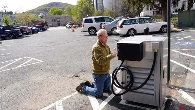 Bob Pingry programs turns the new Subnet electric car charging station in Staunton April 21, 2015. A car can be charged in about an hour. The cost is $12.00 per hour and is billed by the minute. There is a special reserved parking space in the city lot at Johnson and S. New Streets.