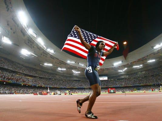 636572637824969727-Beijing-Olympics-Athletics-Mens-100M-OLYAT395.jpg