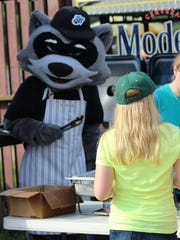 Rascal serves breakfast to Scouts at Dutchess Stadium during a previous scout sleepover.