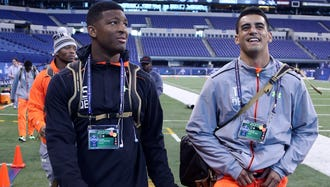 Feb 21, 2015; Indianapolis, IN, USA; Florida State quarterback Jameis Winston (left) and Oregon Ducks quarterback Marcus Mariota walk out together after finishing their workout during the 2015 NFL Combine at Lucas Oil Stadium. Mandatory Credit: Brian Spurlock-USA TODAY Sports ORG XMIT: USATSI-219262 ORIG FILE ID:  20150221_ajw_ss1_237.jpg