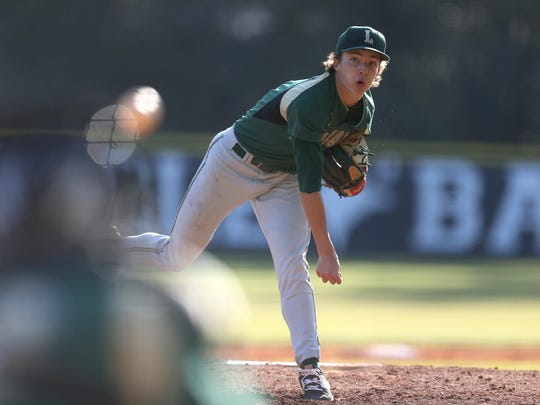 Lincoln's Zach Taylor pitches during a win over NFC at the end of February. Taylor is 7-0 this year with a 1.94 ERA.