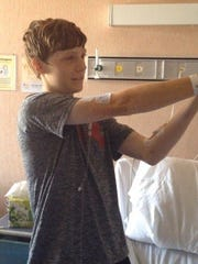 Northwest Rankin's Jacob Chastain shoots Nerf guns at his friends during his initial hospital stay after being diagnosed with leukemia in May 2014.