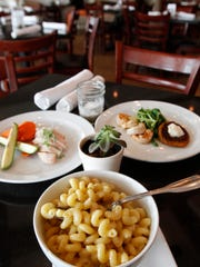 Kid-friendly dishes like mac and cauliflowered cheese, shrimp, with tat soi greens and sweet potato patty and chicken breast w/carrots and grilled torpedo zucchini at The Local, a Naples farm-to-table restaurant using locally sourced ingredients.