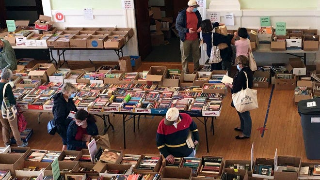 Shoppers explore boxes of books for sale at the Friends of the Thayer Library event last weekend. The sale continues through the Columbus Day weekend. Hours are Friday, Oct. 9, 3 to 7 p.m., with a bag for $15. On Saturday, Oct. 10, hours are 9 a.m. to 4 p.m. On Sunday, Oct. 22, hours are noon to 4 p.m. and Monday, Oct. 12, hours are 3 to 7 p.m. Bags Oct. 10 to 12 are $10.