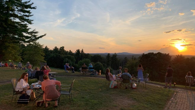 "Picnickers enjoy the sunset at Fruitlands Museum. With the colder weather, Fruitlands will be hosting ""Fire Pit Fridays"" under the stars Nov. 6, 13 and 20."