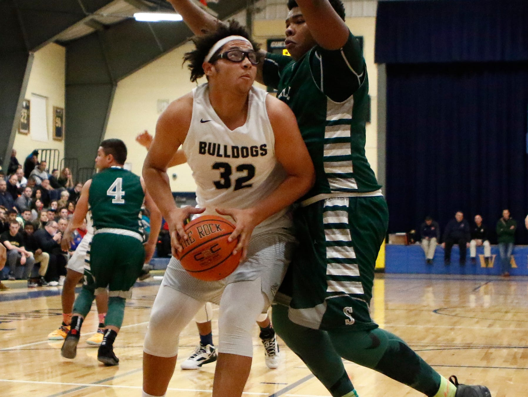 Beacon's Jemond Galloway (32) turns on Spackenkill's Kyiev Bennermon (25) in the championship game of the Duane Davis memorial basketball tournament at Our Lady of Lourdes High School in Poughkeepsie on Saturday, December 31, 2016.