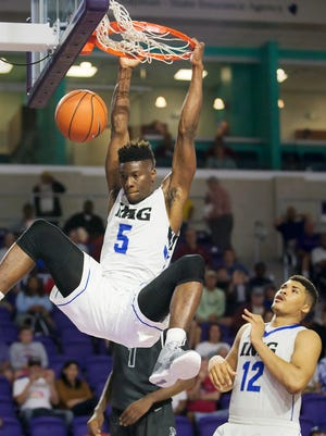 IMG Academy's Emmitt Williams scores against Norcross during play Saturday at the Culligan City of Palms Classic at the Suncoast Credit Union Arena in Fort Myers. Williams scored 19 points in IMG's 62-59 victory.