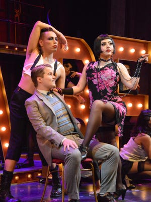 """John Levick, seated, and Lauren Peña, right, play Clifford Bradshaw and Sally Bowles in the UTEP Dinner Theatre's production of """"Cabaret."""""""