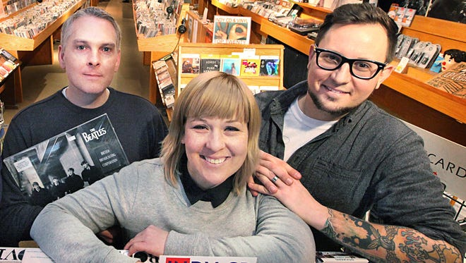 The new owners of Indy CD and Vinyl (from left, Eric Davis, Annie Skinner and Andy Skinner) pose at the Broad Ripple store.