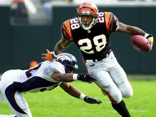 Bengals running back Corey Dillon avoids a tackle running
