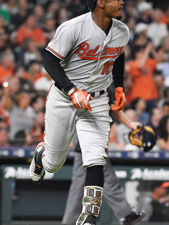 Baltimore Orioles' Adam Jones watches his two-run home run off Houston Astros starting pitcher Justin Verlander during the sixth inning of a baseball game, Tuesday, April 3, 2018, in Houston. (AP Photo/Eric Christian Smith)