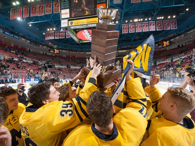 Michigan raises the MacInnes Cup after defeating Michigan