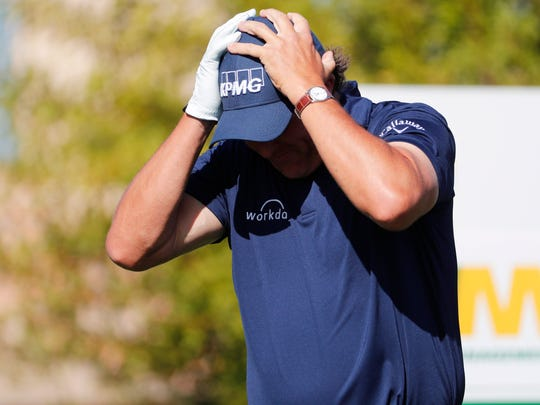 Phil Mickelson reacts to his tee shot on the second