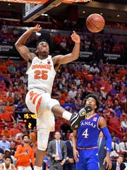 Syracuse Orange guard Tyus Battle (25) reacts after dunking the ball against the Kansas Jayhawks during the second half at American Airlines Arena.