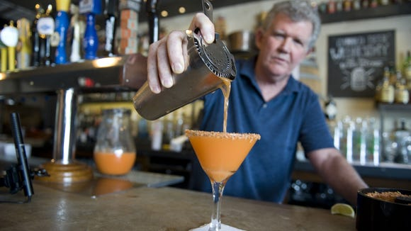 Kevin Meeker, owner at Keg & Kitchen in Westmont, mixes a carrot-infused rum drink. at his restaurant. Meeker will enter into a contract with Camden County to reopen the Lobster Trap as a new business.