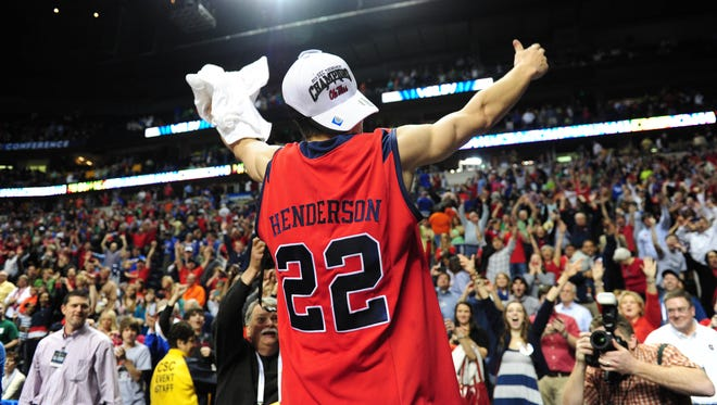 Mississippi Rebels guard Marshall Henderson (22) raises his hands to the crowd after the Rebels defeated the Florida Gators during the championship game of the SEC tournament.